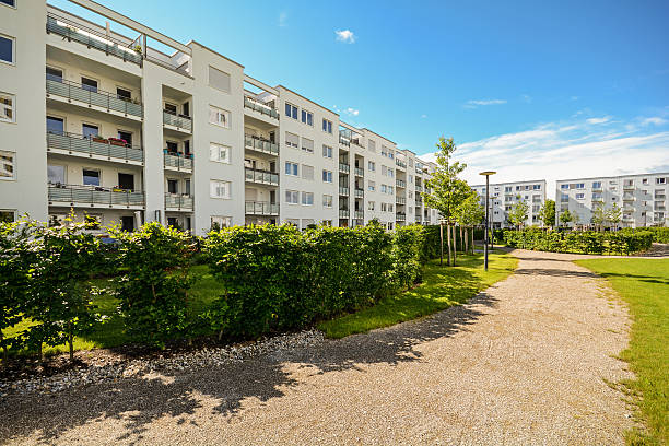 Apartment building in the city, Facade of new residential houses stock photo