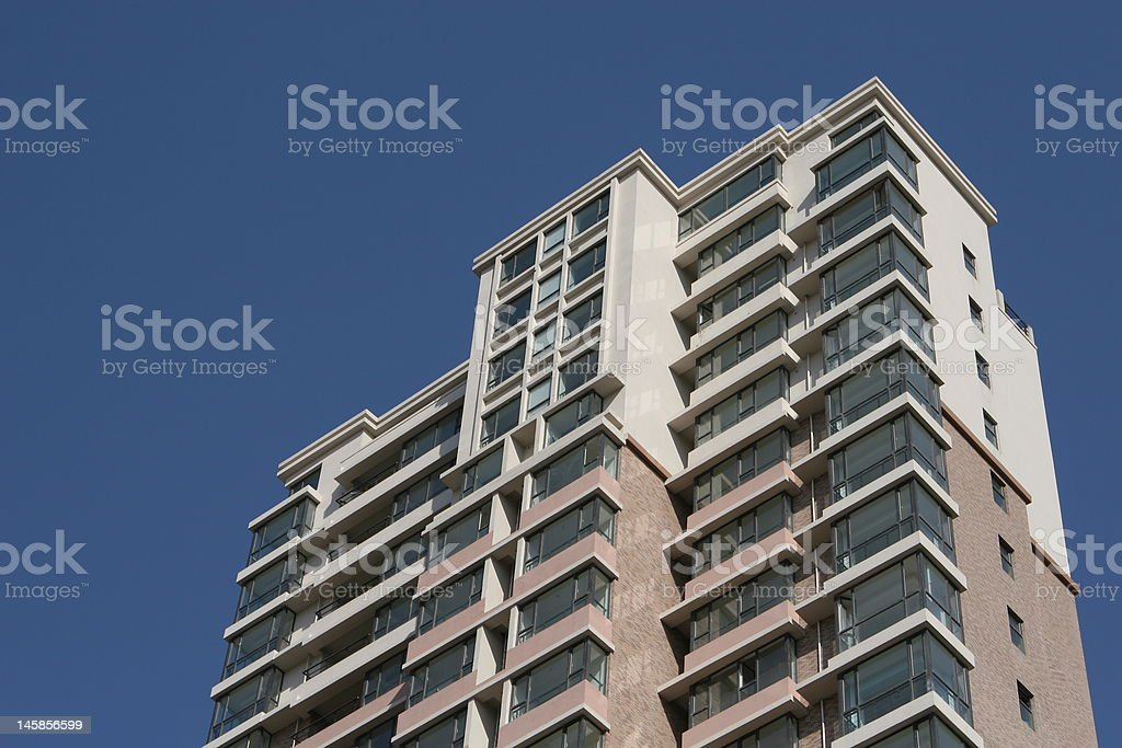 apartment building under clear blue sky royalty-free stock photo