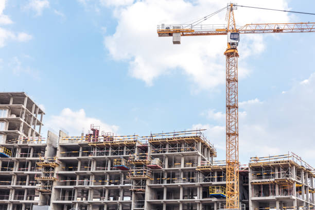 apartment building under construction with scaffolding stock photo