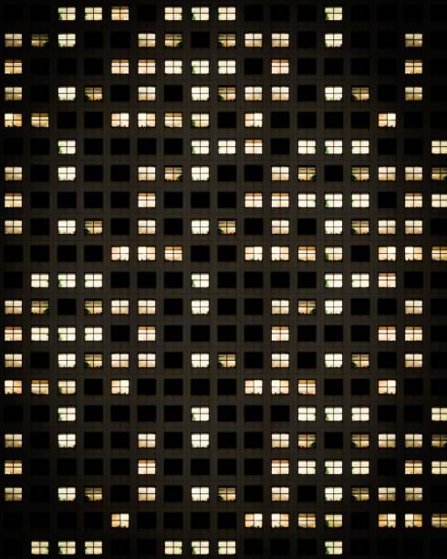 Apartment Building Windows at Night stock photo