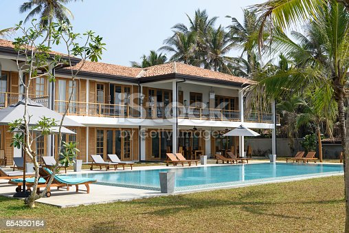 Luxury holiday home with outdoor pool and sun loungers