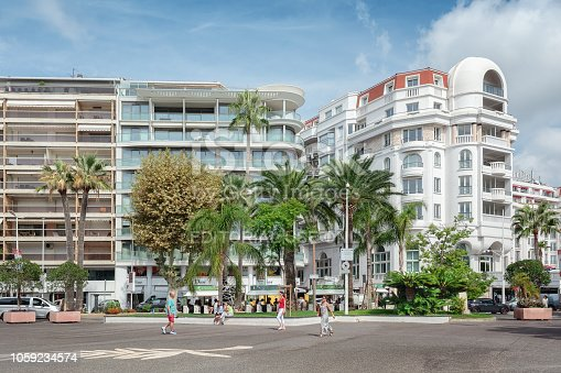 istock Apartment buildings and the side of the well known hotel   Majestic Barriere along the famous boulevard de la Croisette in Cannes 1059234574