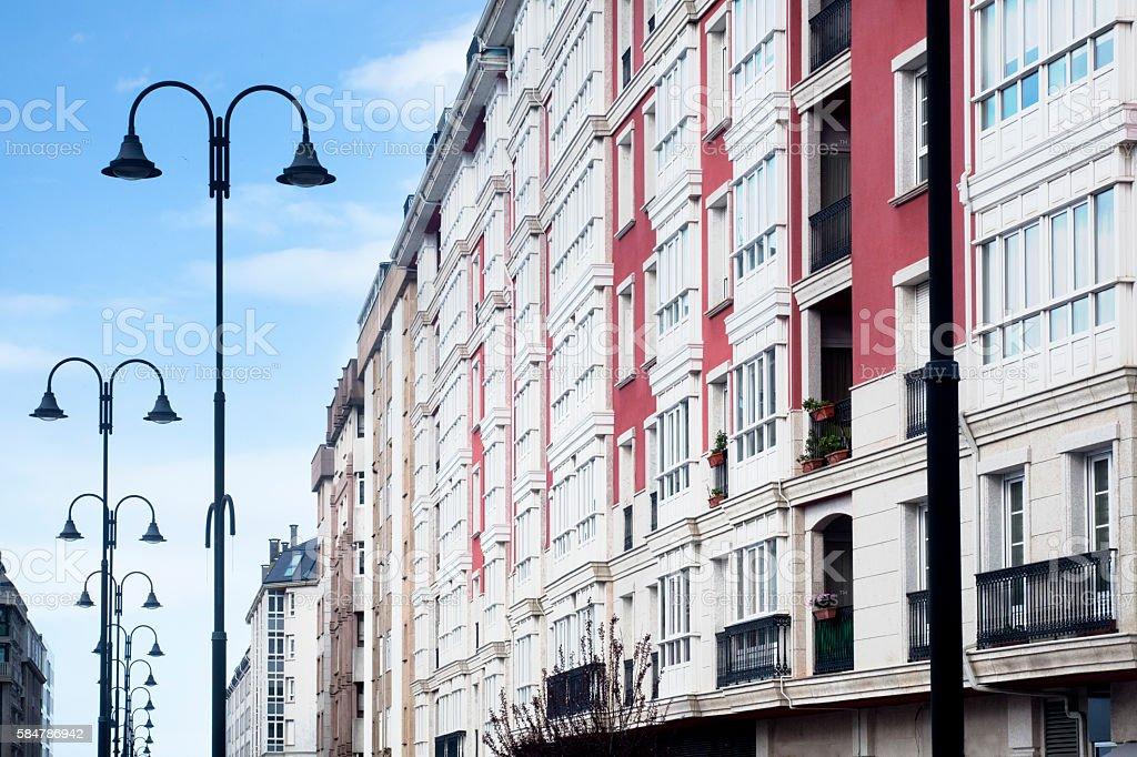 Apartment buildings, avenue, modern street lights. stock photo
