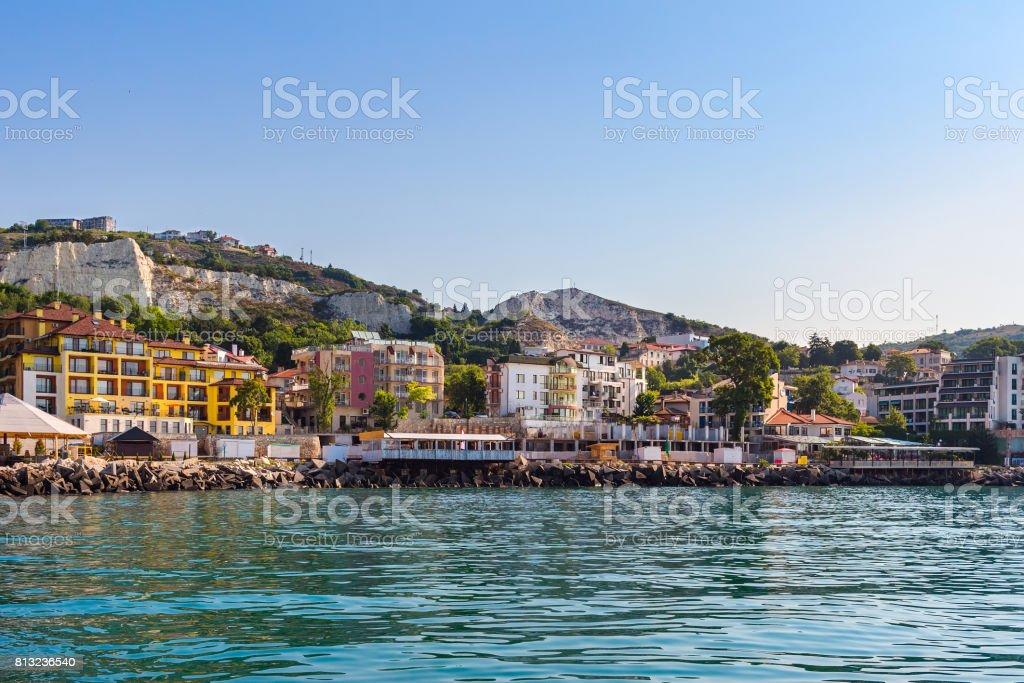 Apartment buildings on seashore in balchik city on black sea coast in Bulgaria at sunny summer day stock photo