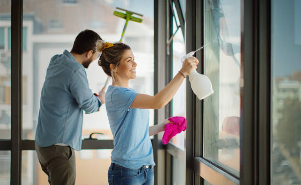 Apartment cleaning during pandemic lockdown. stock photo