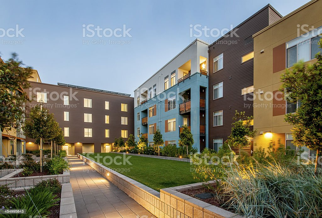 Apartment Complex, Dusk. stock photo