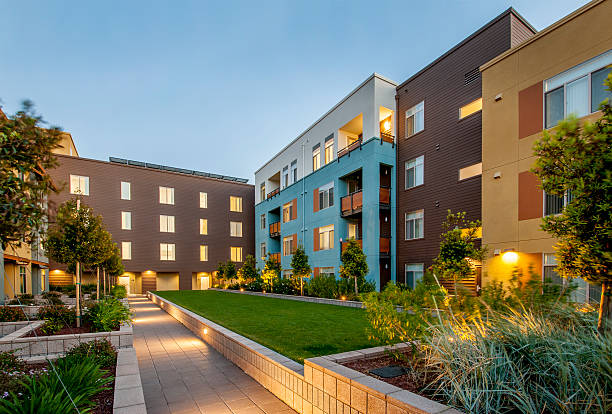 Apartment Complex, Dusk. Modern apartment building at dusk. courtyard stock pictures, royalty-free photos & images