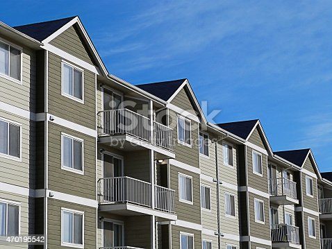 istock Apartment Complex With Blue Sky 470195542