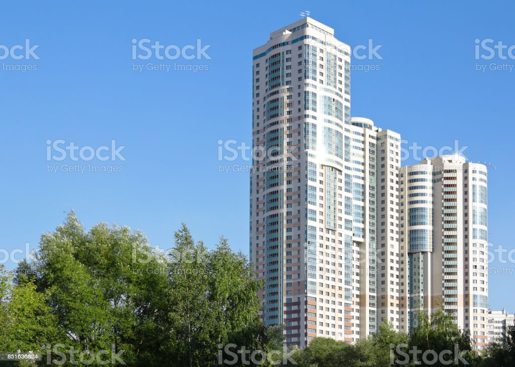 apartment house against the blue sky stock photo