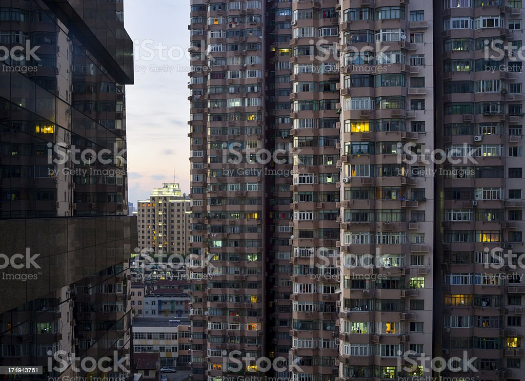 Apartment House at Night in Shanghai China Evening view of a tall apartment house in Shanghai. Apartment Stock Photo