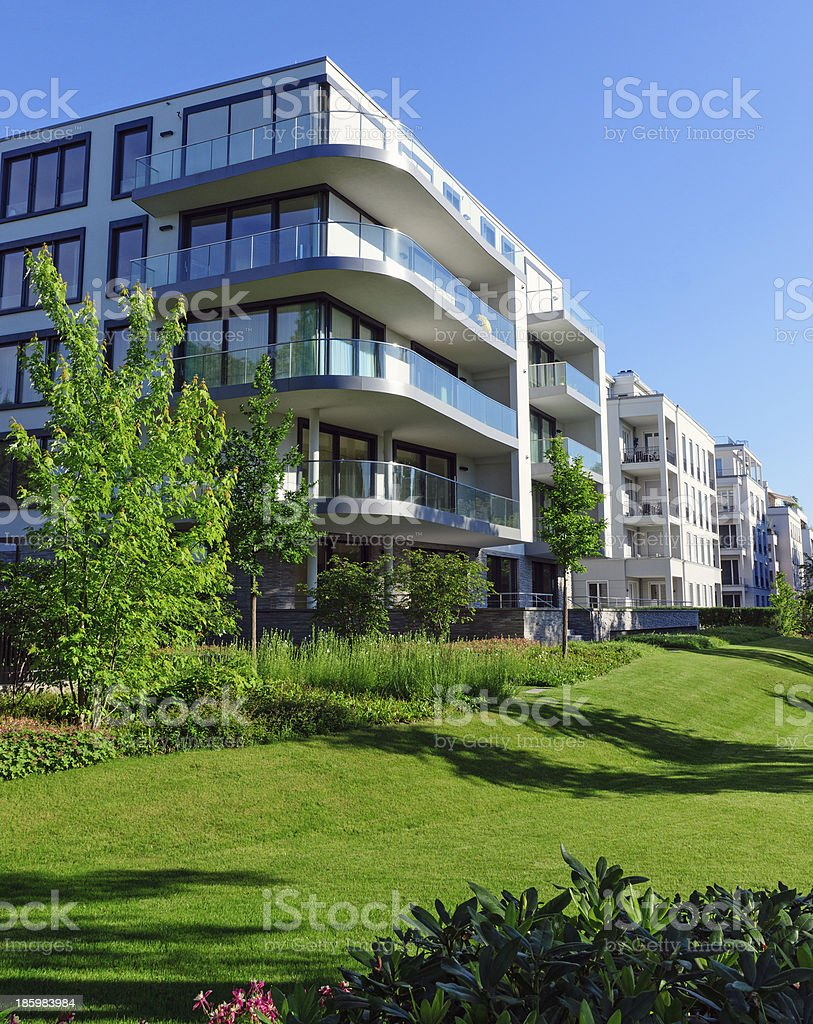 Apartment houses and green grass stock photo