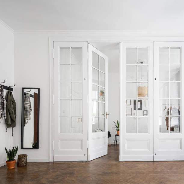 Apartment interior with open doors stock photo