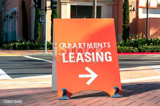 Apartments leasing sign promote the rental property and shows direction where the rental office is located.
