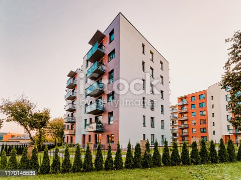 1165384568 istock photo Apartment modern house home residential building real estate outdoor evening 1170145539