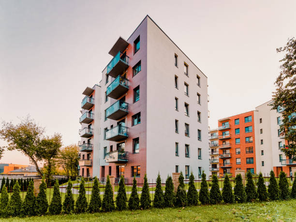 Apartment modern house home residential building real estate outdoor evening stock photo