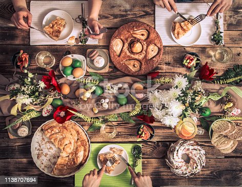 istock Apartment-feast of friends or family at the festive table with rabbit meat, vegetables, pies, eggs, top view. 1138707694