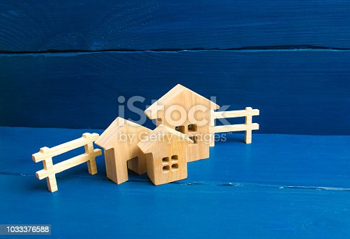 915688450istockphoto Apartments and apartments. City, settlement. Three houses on a blue background. Buying and selling of real estate, construction.Minimalism. for presentations. real estate market. 1033376588