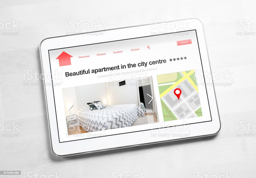 Apartments and houses online search with mobile device. Holiday home rental or real estate website or application. stock photo