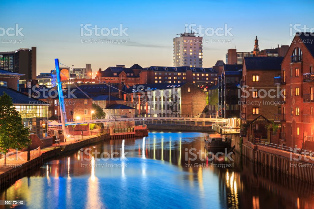 Apartments, bars and restaurants along the river Aire in the centre Leeds at night stock photo