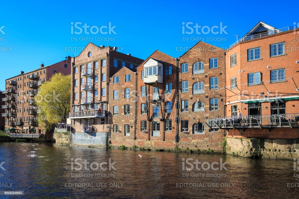 Apartments, bars and restaurants on the river Aire in Leeds, Yorkshire. stock photo