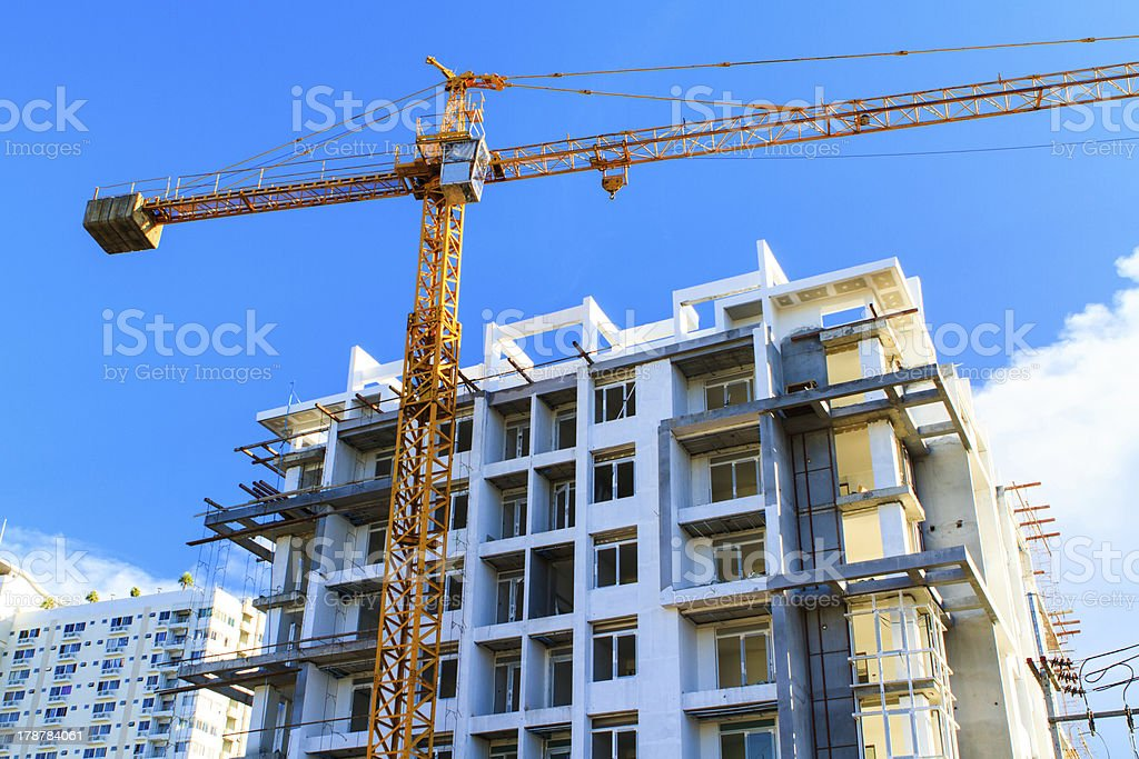 Apartments construction site with yellow crane royalty-free stock photo