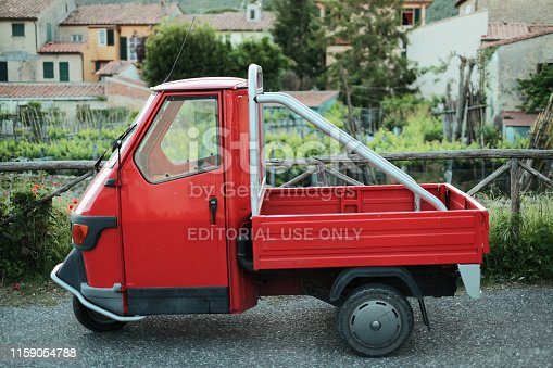 Calci, Italy - May 16, 2019: in the quiet and small village of Calci in the province of Pisa, this ApeCross manufactured by Piaggio is parked overlooking an idyllic scenery.