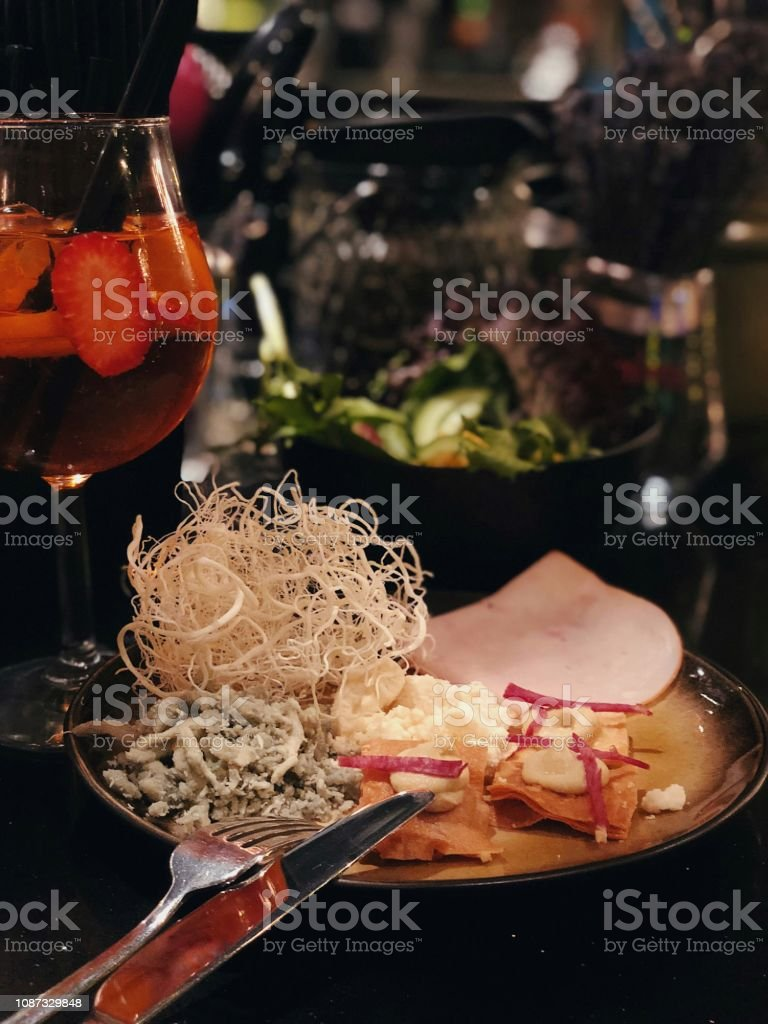 Aperitivo plate with aperol spritz cocktail stock photo