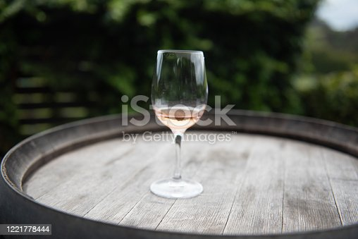 having a glass of wine in the garden