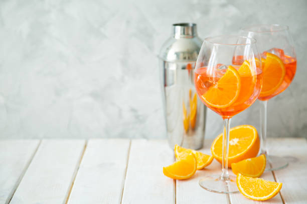 Aperol and ingredients drinks on wood background