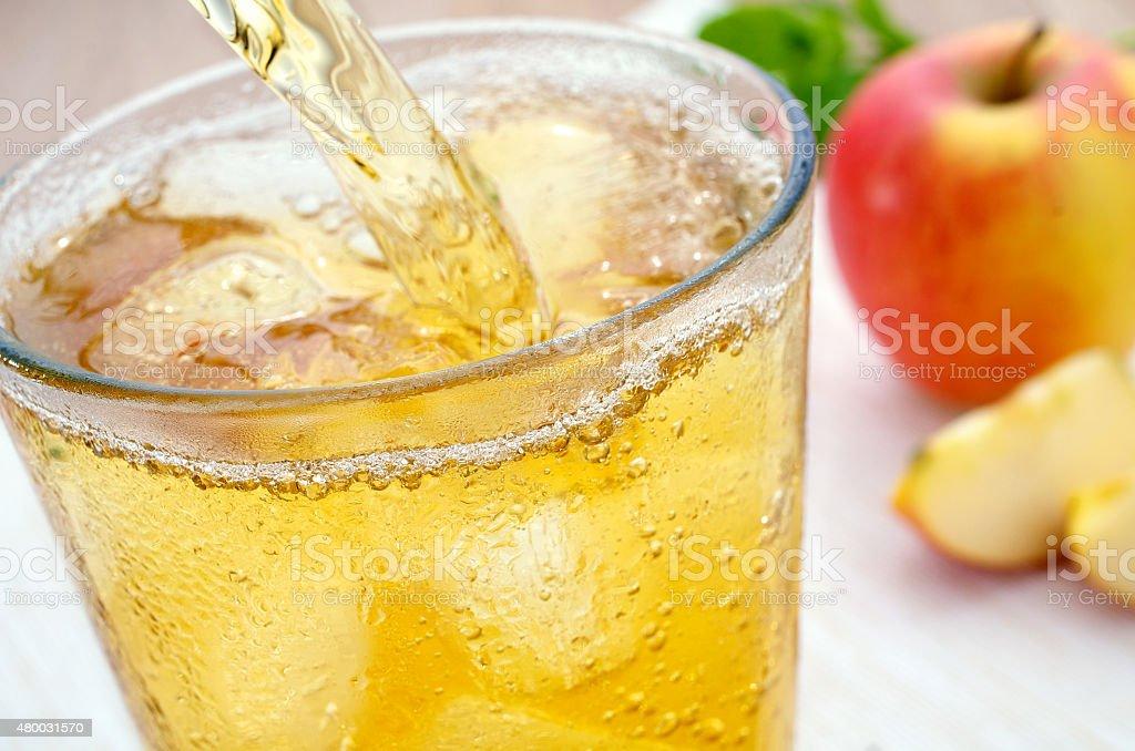 Apfelschorle einschenken Apple juice spritzer stock photo