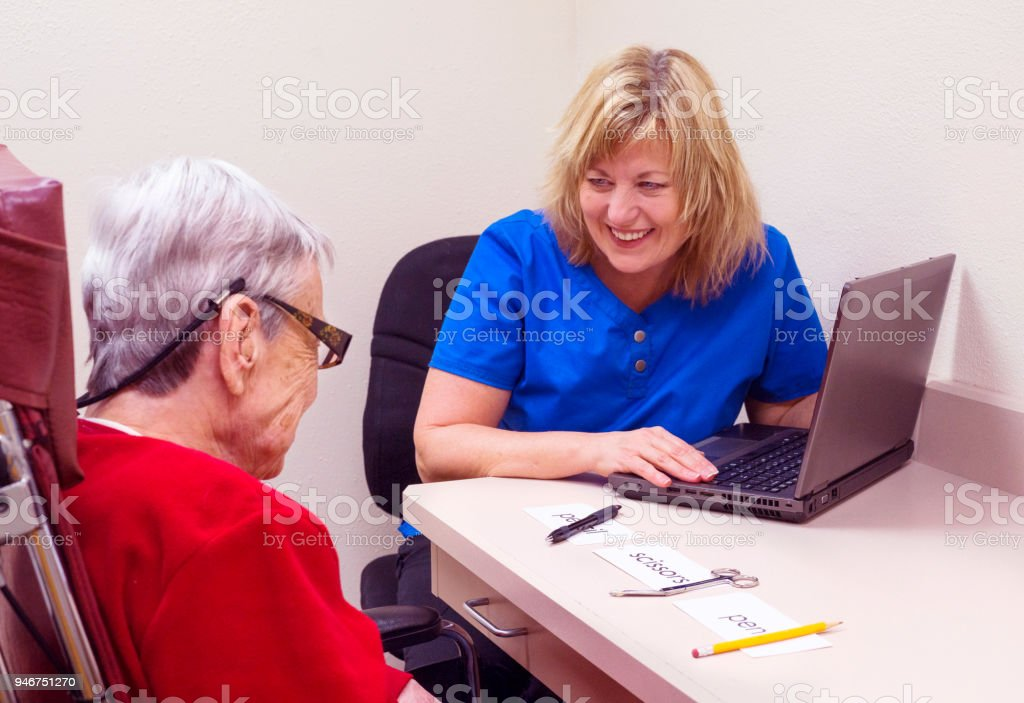 Aphasia patient works on visual comprehension in speech therapy stock photo