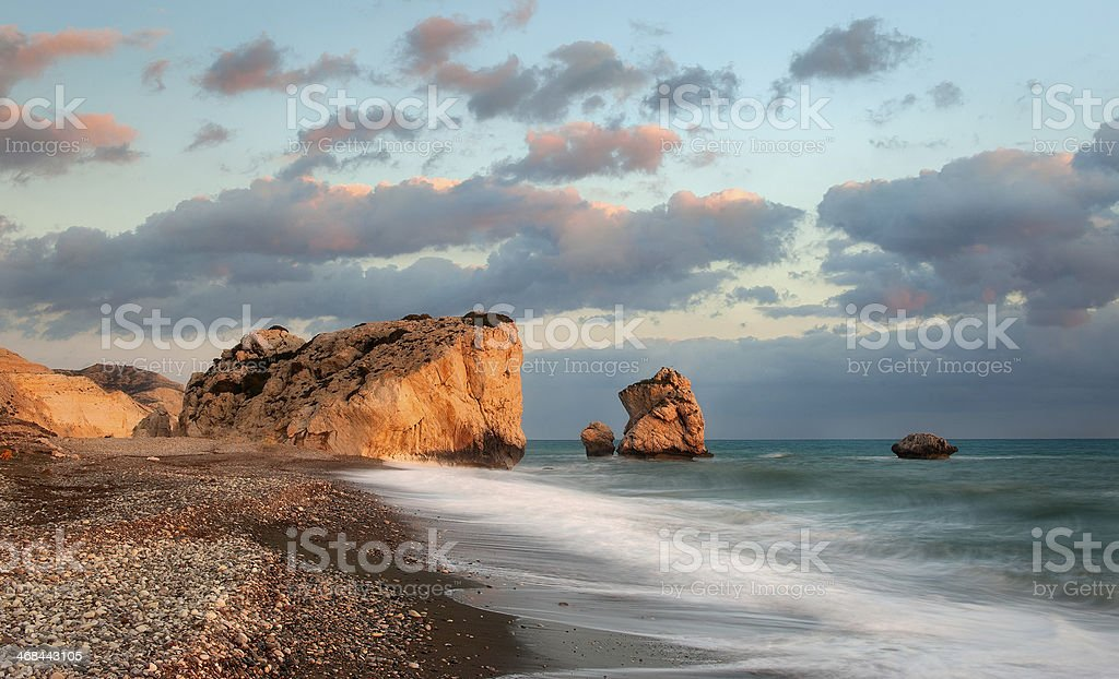 Aphrodite's Rock in the setting sun stock photo