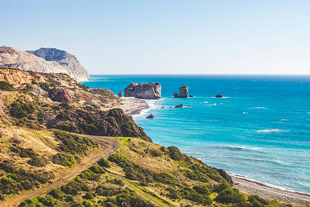 aphrodite's rock - cyprus стоковые фото и изображения