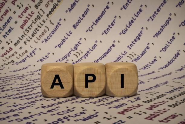 api - cube with letters and words from the computer, software, internet categories, wooden cubes stock photo