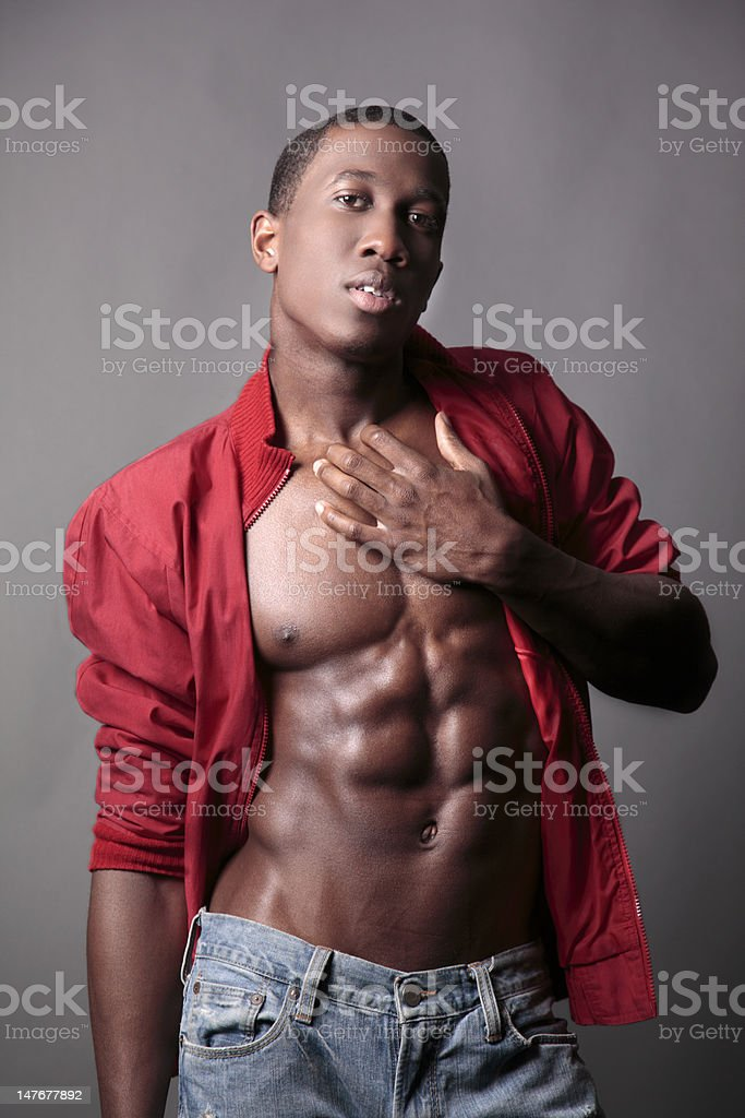 Apologetic Young Male Shows off his abs royalty-free stock photo