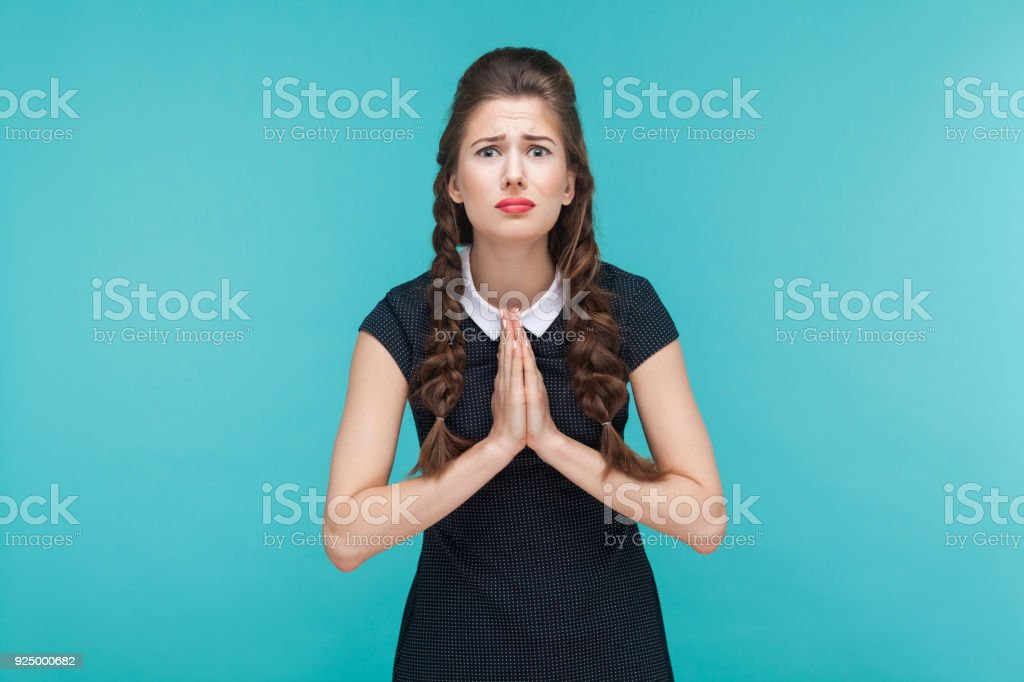 Apologize woman looking at camera and hope. stock photo