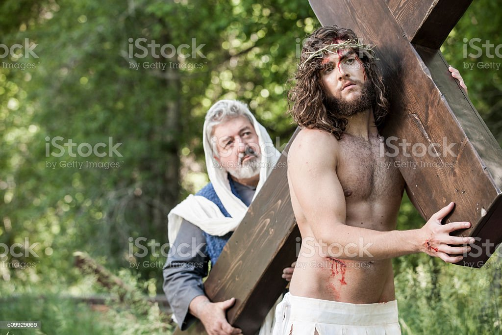 Apostle Helping Jesus Christ to Carry Cross stock photo