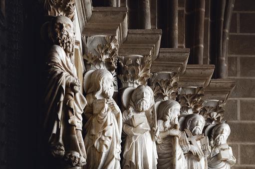 Apostles on a medieval church portal in evora, portugal