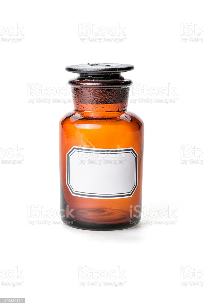 Apothecary bottle made of brown glass with empty label stock photo
