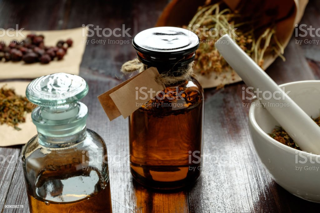 apothecary vintage set of bottles, herbs and mortar stock photo