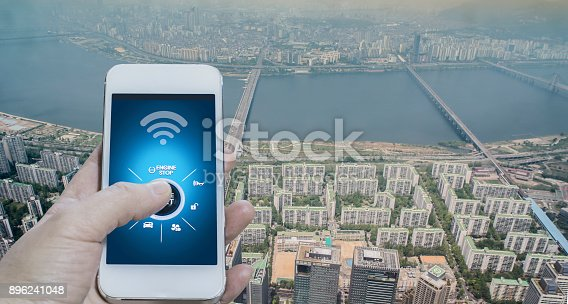 501071464 istock photo App connects to car and let user control it, city background 896241048