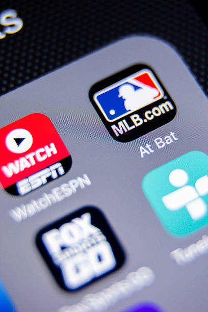 MLB App Icon on iPhone La Habra, United States - August 2, 2016: Macro closeup image of MLB app icon among other icons on an iphone smartphone device.  major league baseball stock pictures, royalty-free photos & images