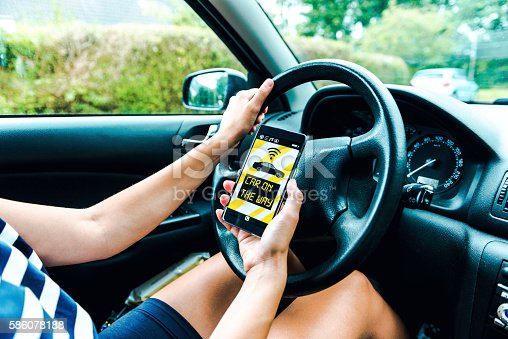 istock App on phone to connects driver to customers 586078188