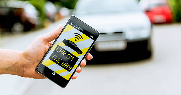 App on smart phone connects to a car or taxi ストックフォト