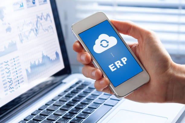 ERP app on smartphone screen connecting data with cloud computing stock photo