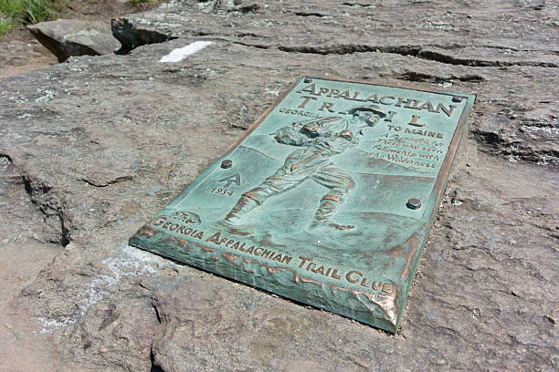 Appalachian Trail Plaque on Springer Mountain Dahlonega, Georgia, United States - May 2, 2015: A copper plaque marks the beginning (or end) of the famed Appalachian Trail appalachian trail stock pictures, royalty-free photos & images
