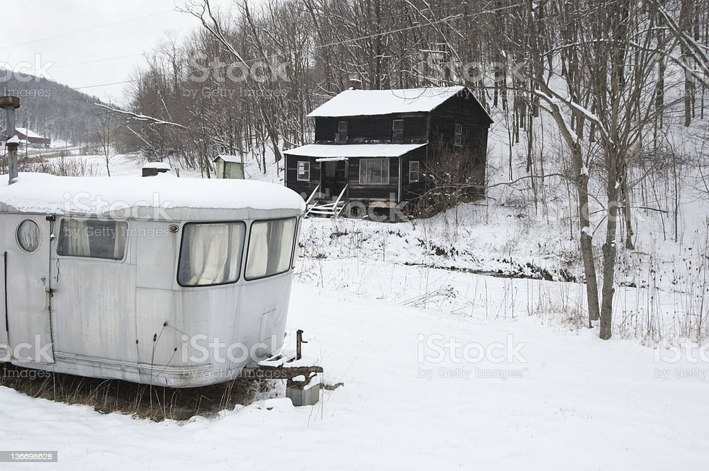 Appalacia nHillbilly Shack House and Silver Trailer Mobile Home stock photo