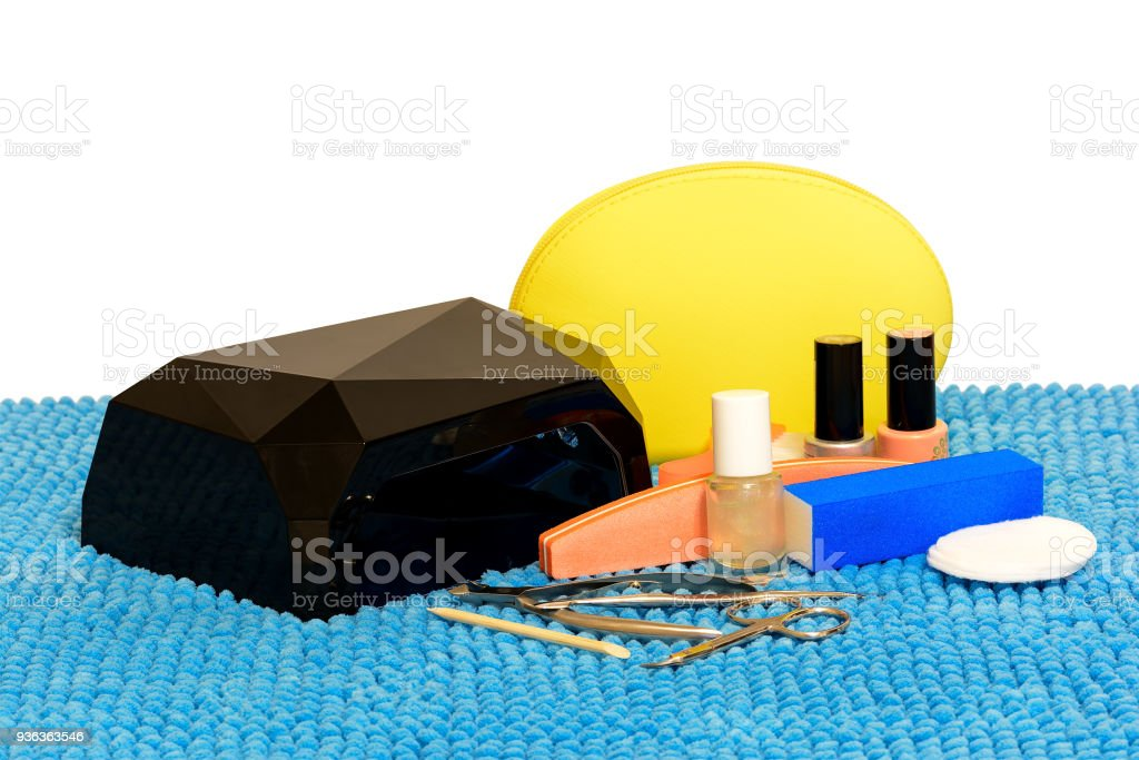 Apparatus and a set of tools for manicure. UV/LED lamp for drying,    polymerization gel-varnish for nails. Isolated, white background. stock photo