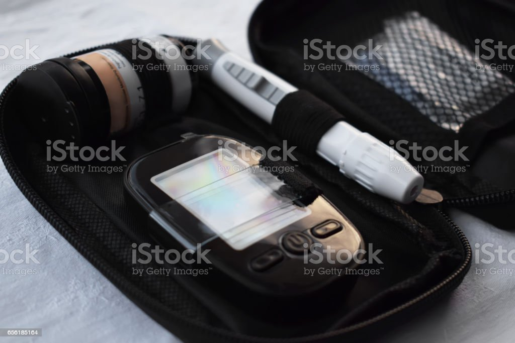 Apparatus for measuring the level of glucose in the blood stock photo