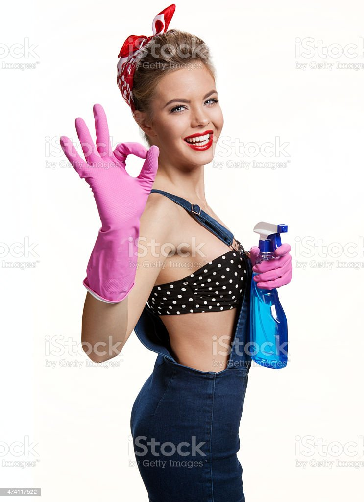 Appealing cleaning woman Showing Us It's Okay stock photo